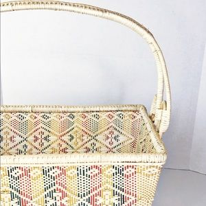 Multicolor weaved basket with handle